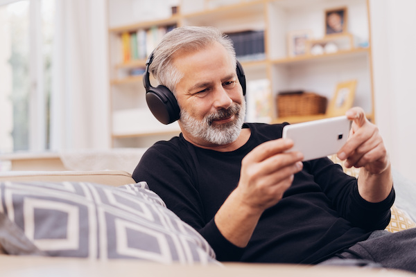 photo of man listening to podcast